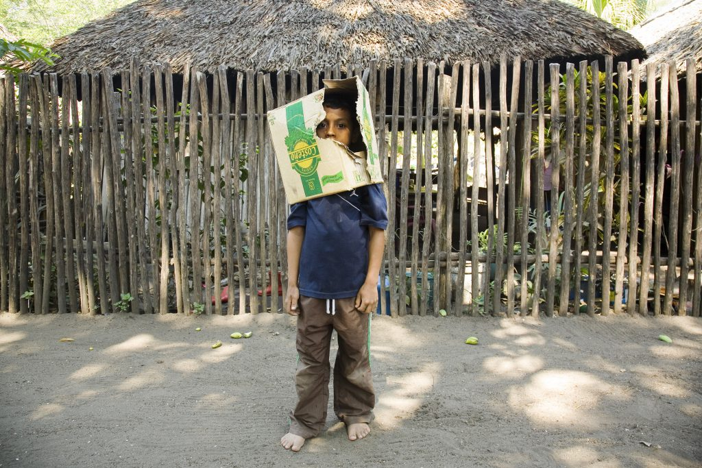 boy with box on head