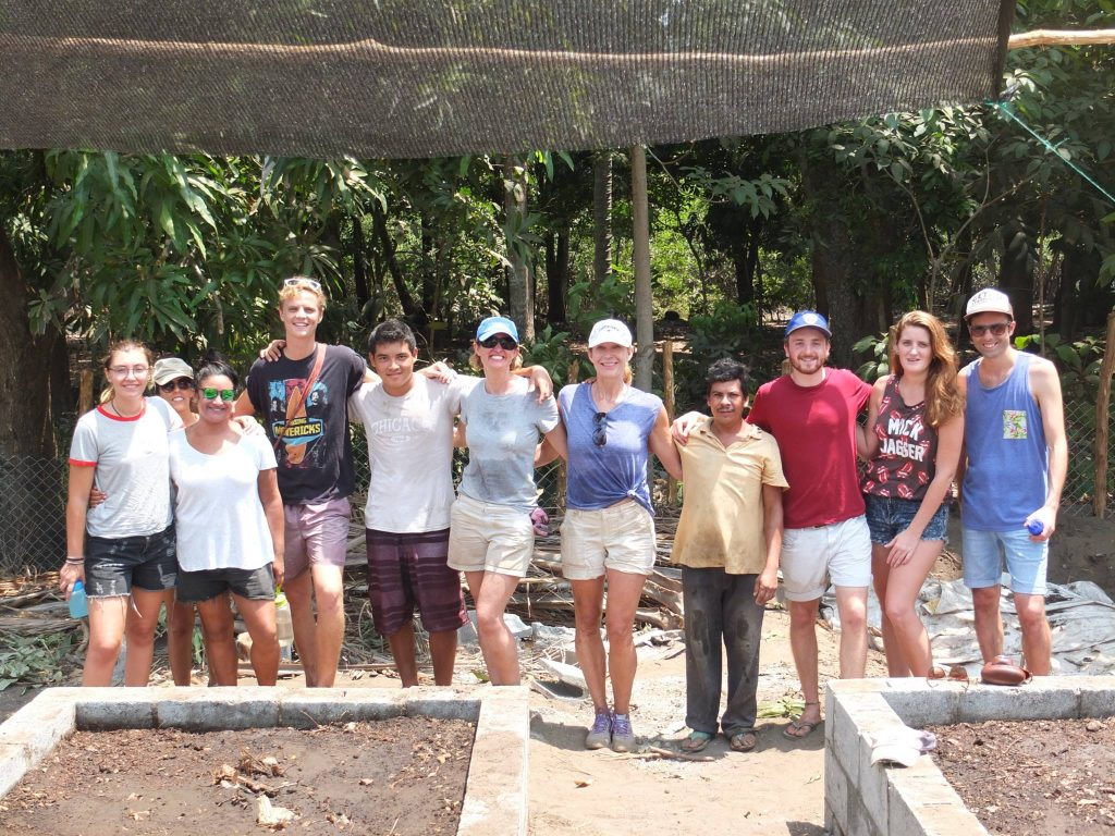 volunteers and staff at permaculture garden